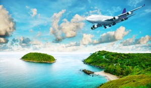 Jet liner over the tropical island. Panoramic composition in ver